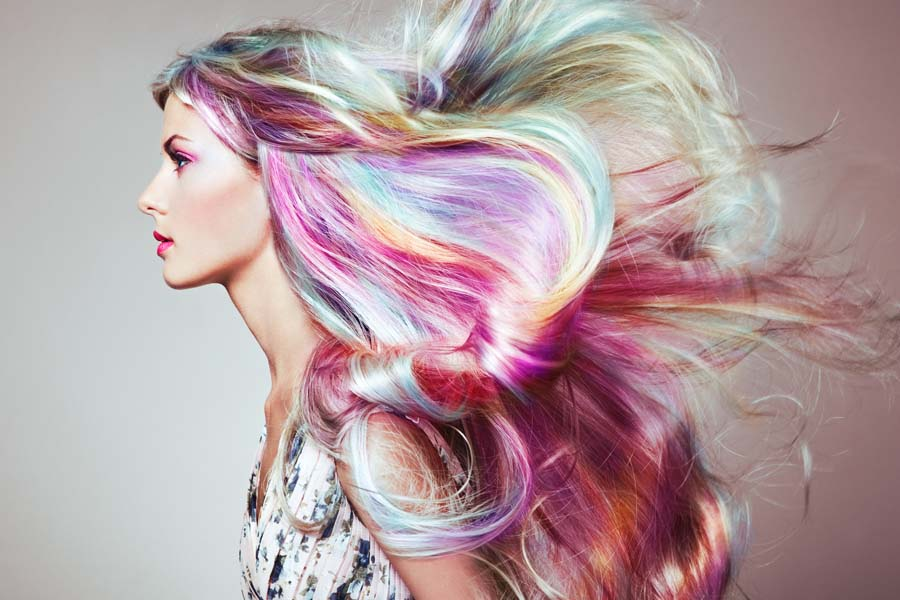 Woman with flowing rainbow dyed hair